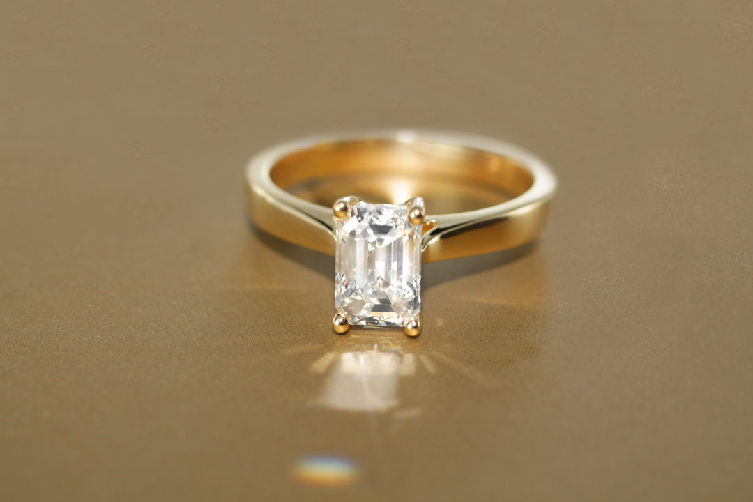 An emerald shaped diamond held up to the light